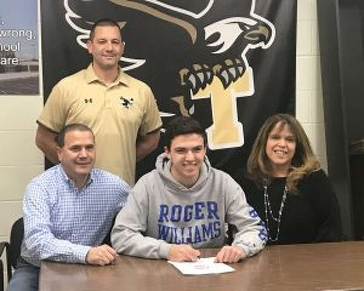 Flanking Ryan Gomes are mom Cindy and dad David, along with THS head baseball coach Phil Pacelli.