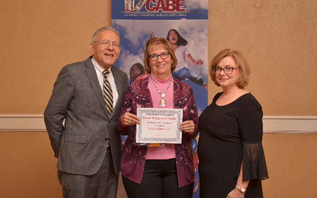 School Supt. Gary Cialfi and board Chairman Loretta Chory receive a recognition award from state Education Commissioner Dianna R. Wentzell.
