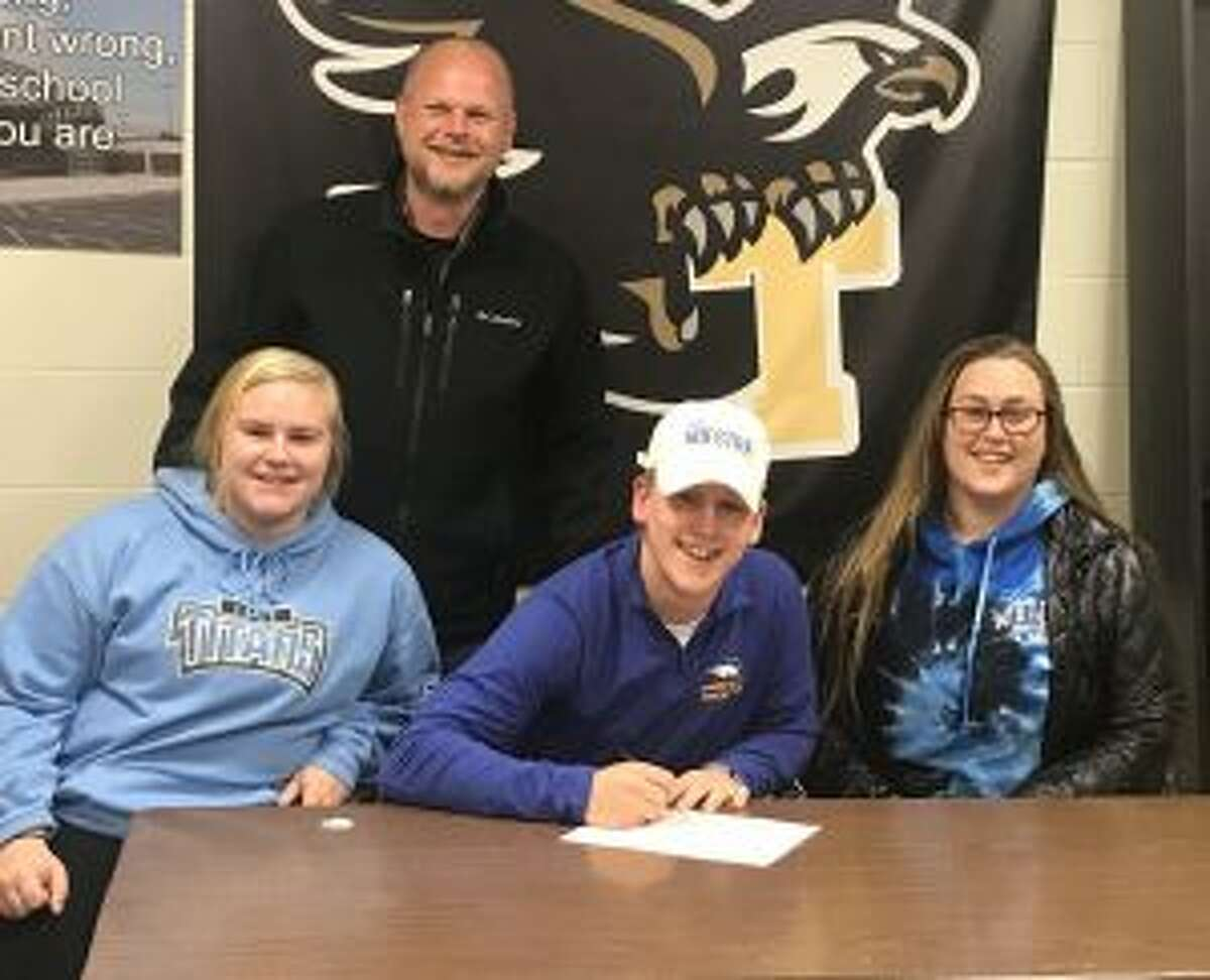 Joining Kevin Bruggeman at the signing ceremony are dad Marc and sisters Mackenzie and Ashley.