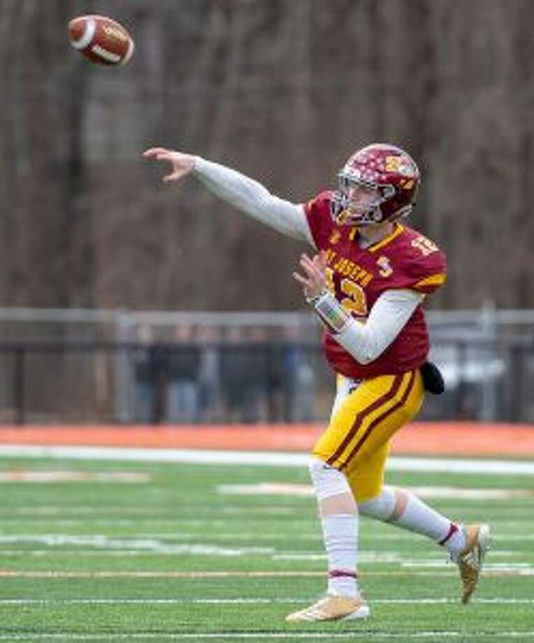 David Summers capped his scholastic career by throwing for six touchdowns and running for another. — David G. Whitham photos