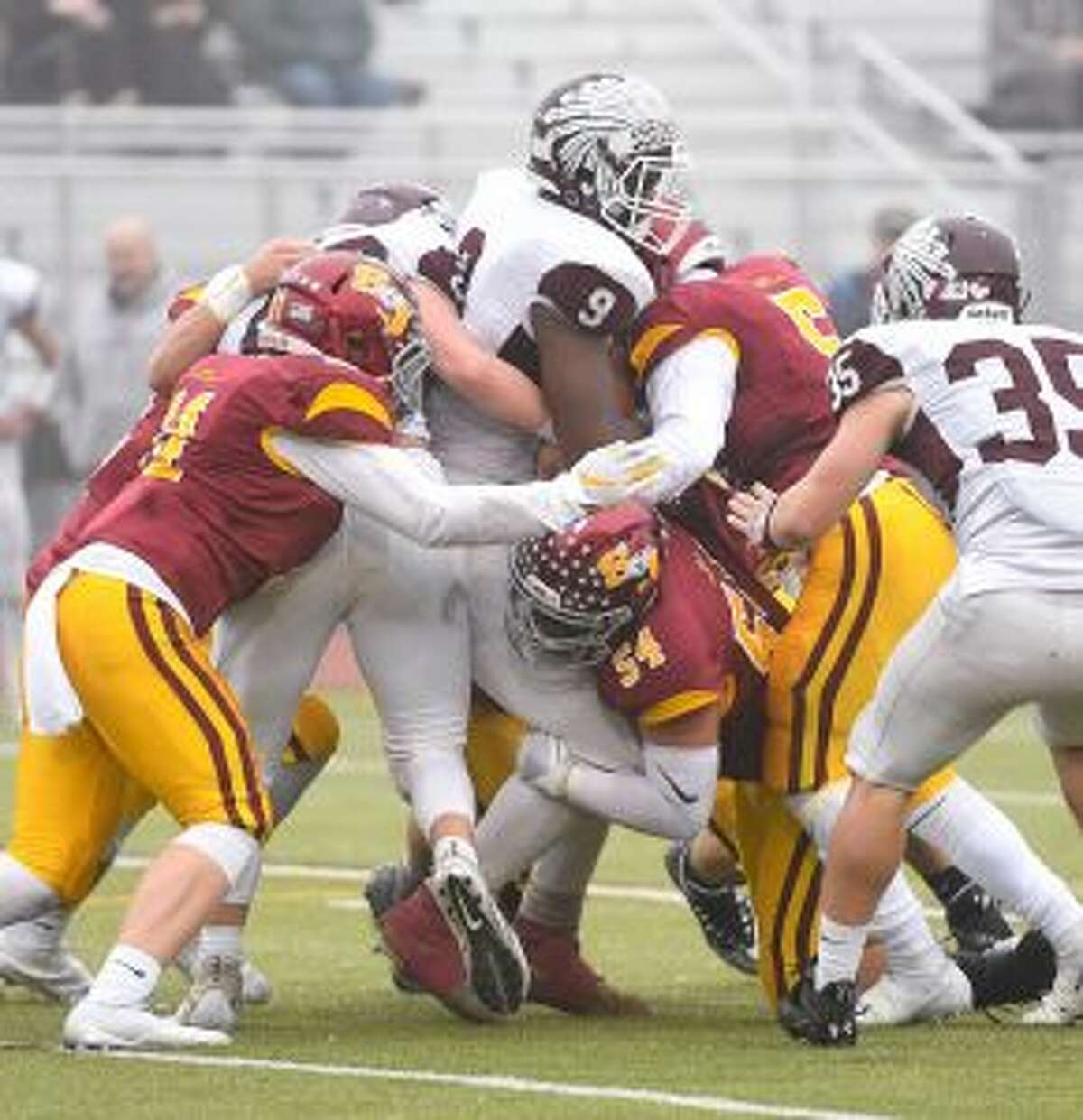The Hogs swarm to the ball. Killingly came into the state semifinal averaging 43 points per game. - David G. Whitham photo