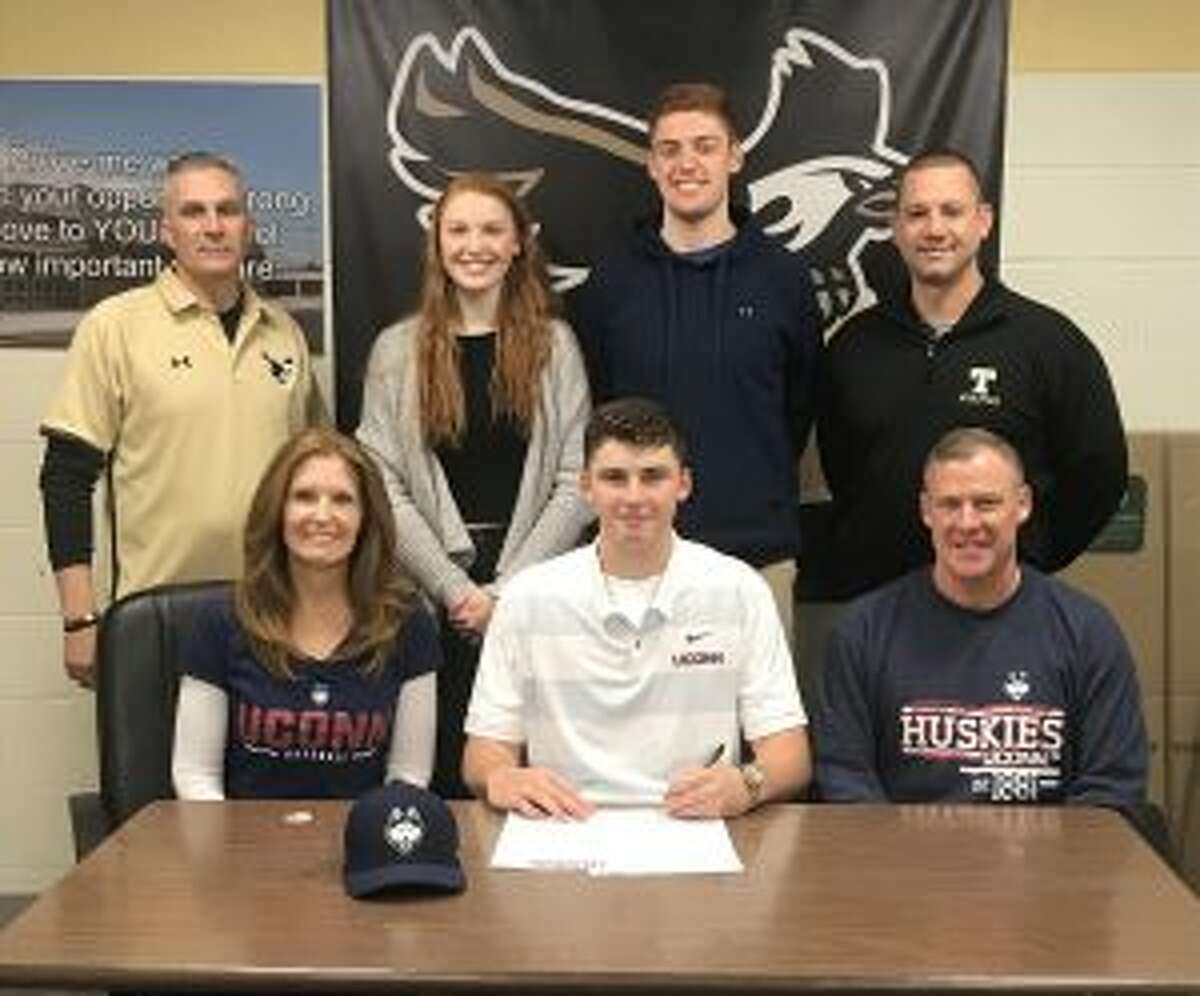 Trumbull High's Chris Brown signed a letter of intent to play baseball at the University of Connecticut. Pictured with Chris are mom Nancy and dad Bill; (back row) THS assistant coach Buddy Bray, sister Taylor, brother Billy and THS head baseball coach Phil Pacelli.