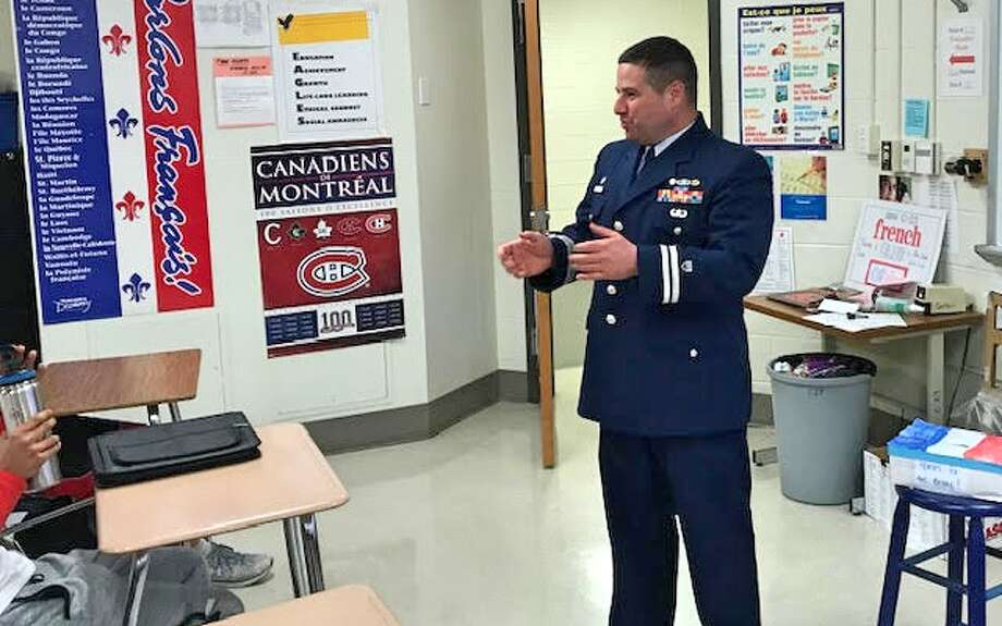 Trumbull High French teacher Shaun Liebskind speaks to students about his experience as an officer in the U.S. Army. — Michael Cerulli photo