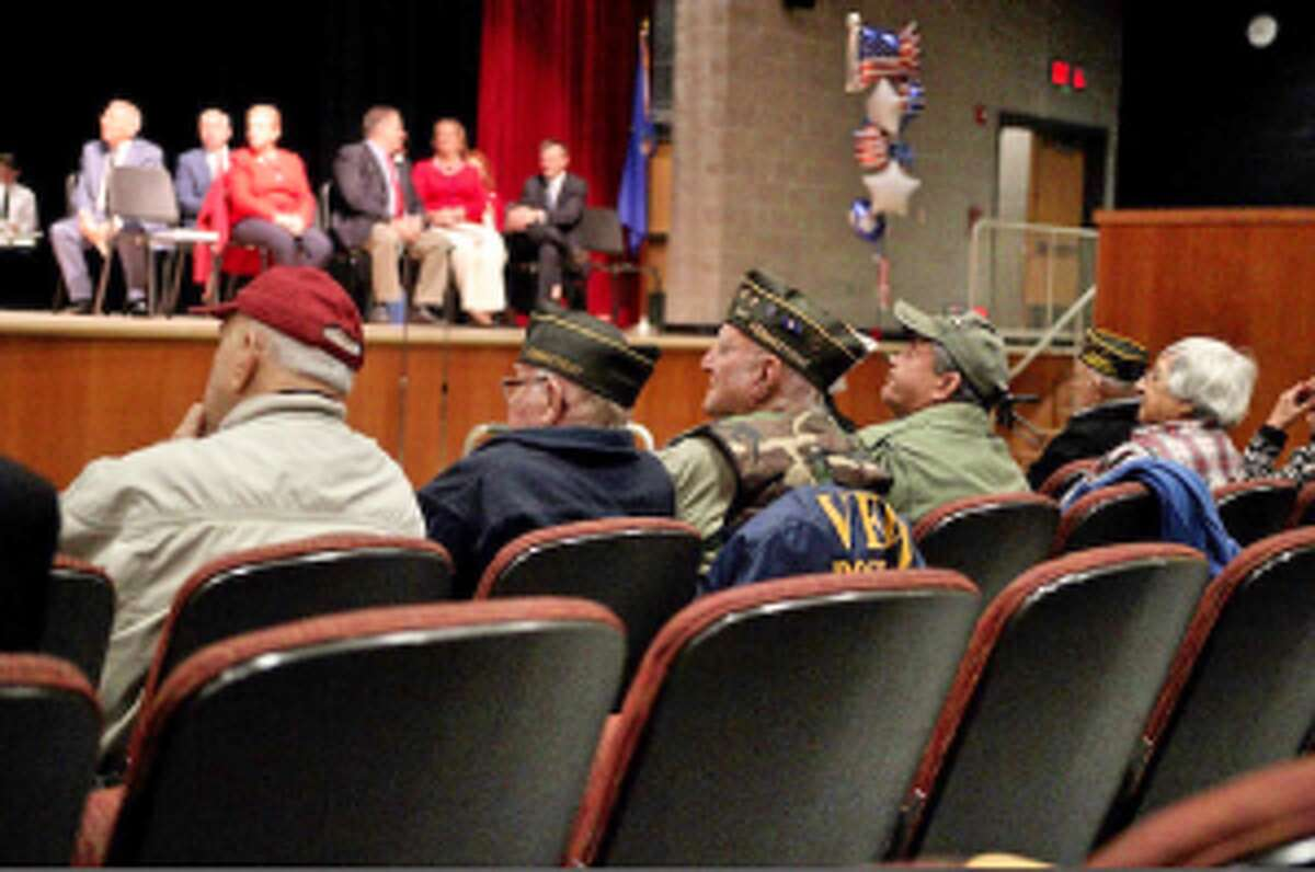Veterans listen to stories and commentaries during the Trumbull High veterans assembly. - Aleksandra Misiewicz photo