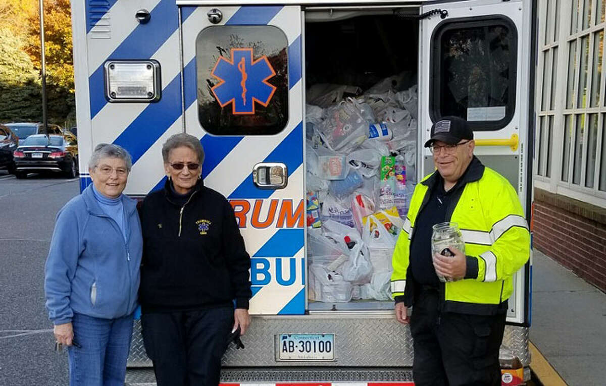 EMS Commissioner Diane Mayo and EMTs Vi Watson and Michael DelVecchio.