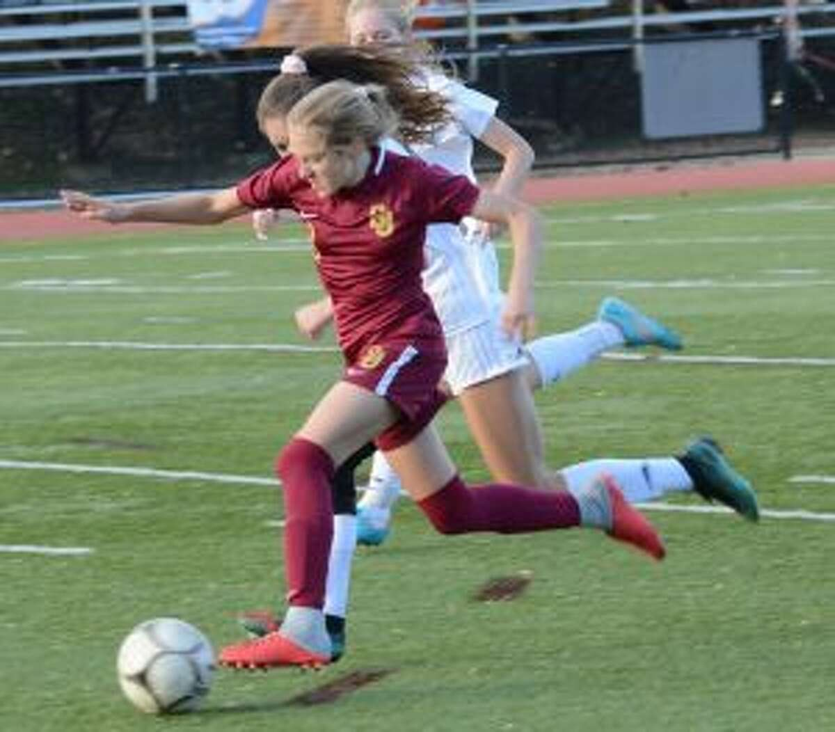 Mary Lundregan makes a run against Wilton. - Andy Hutchison photos