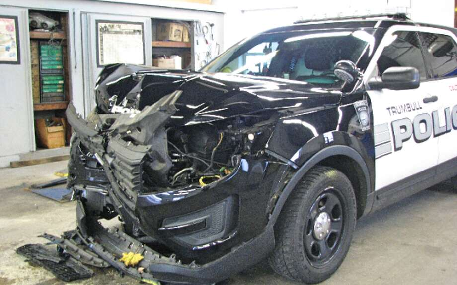 The police K9 vehicle damaged in the arrest is awaiting repairs at a Bridgeport body shop. — Donald Eng photo
