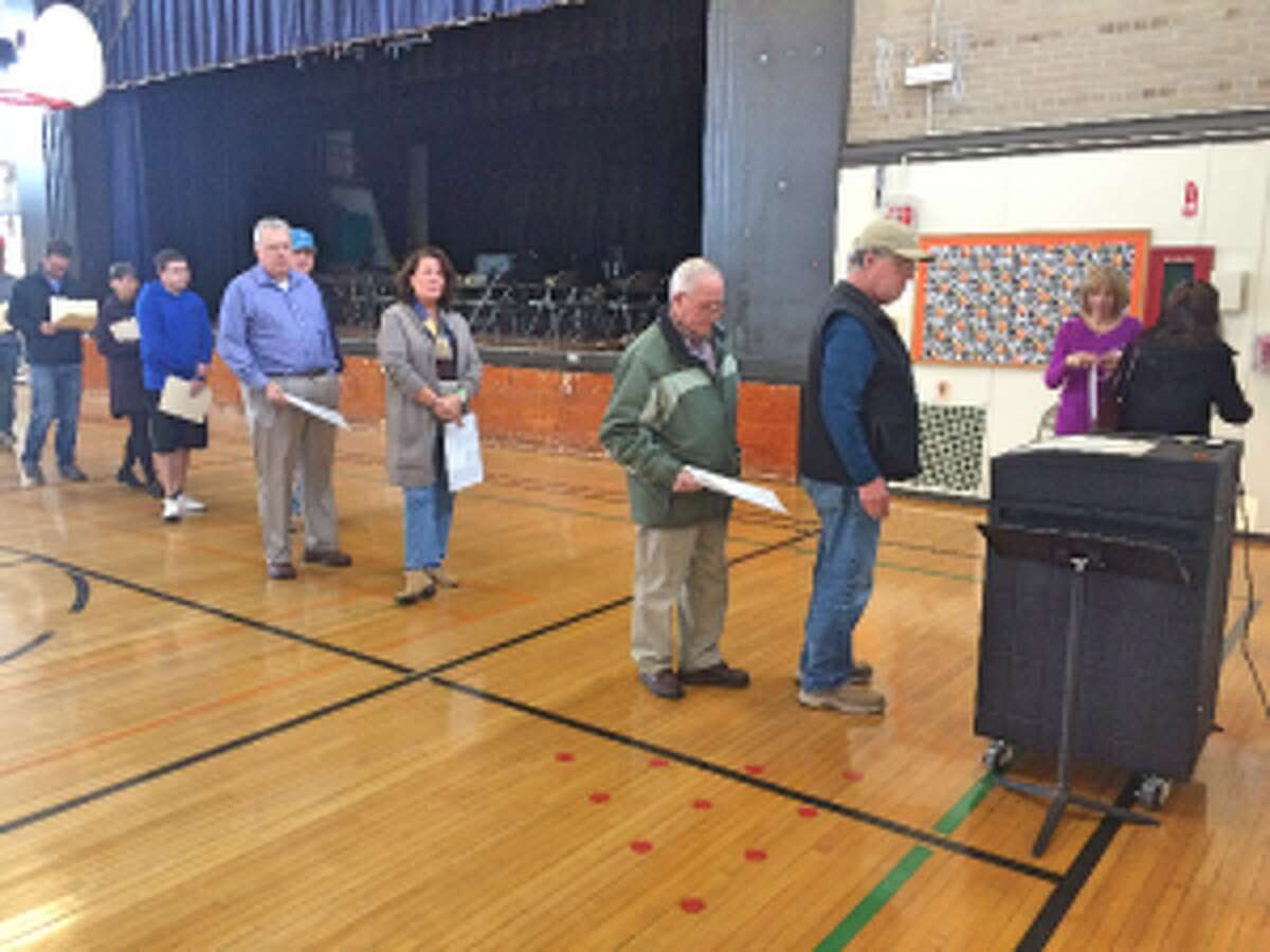 Voters line up to submit their ballots at Middlebrook school. - Donald Eng photo