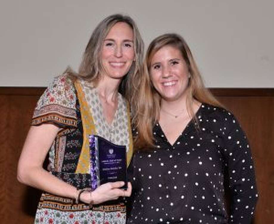 Jessica Batcha, Stonehill Class of '99, (left) was presented for induction to the Hall of Fame by recent volleyball alum Marykay Nasby '18. — Jan Volk/SportsPix/Stonehill Athletics photo