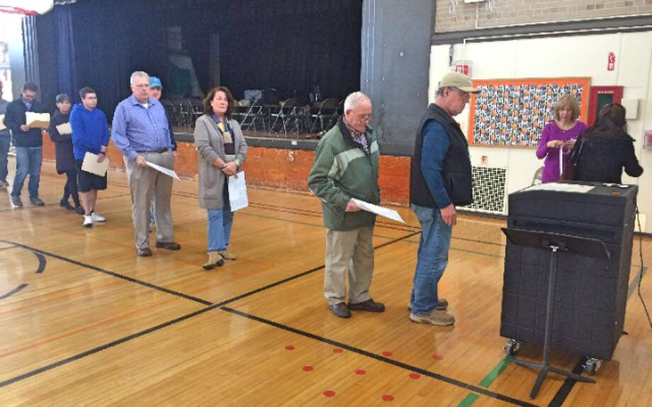 Voters line up to submit their ballots at Middlebrook school. — Donald Eng photo