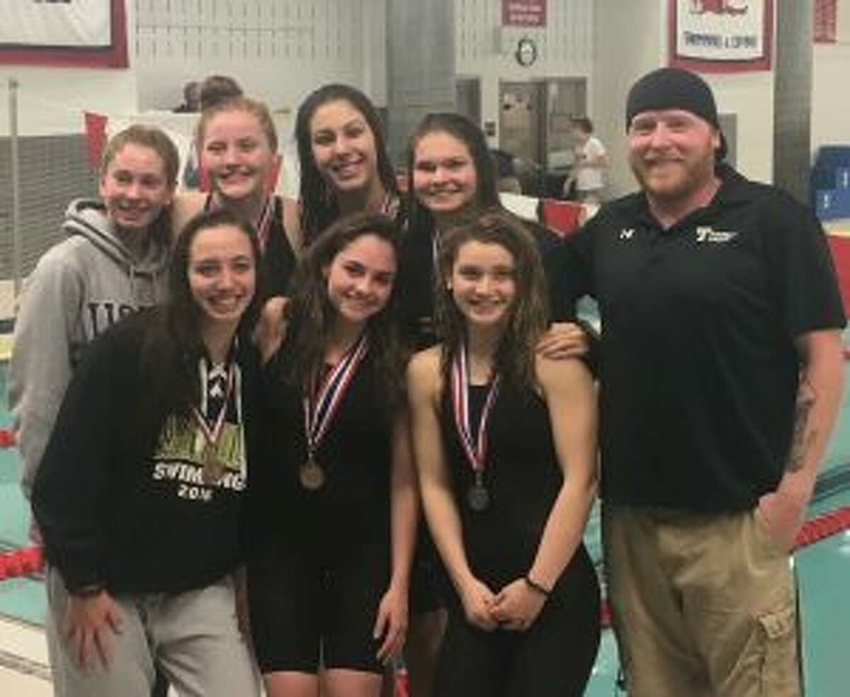 Team members (front row) Julia Nevins, Ashley Piro, Reagan Ryan and coach Bill Strickland; and (second row) Jackie Dale, Lauren Walsh, Mia Zajac and Karina Walsh get together at FCIACs.