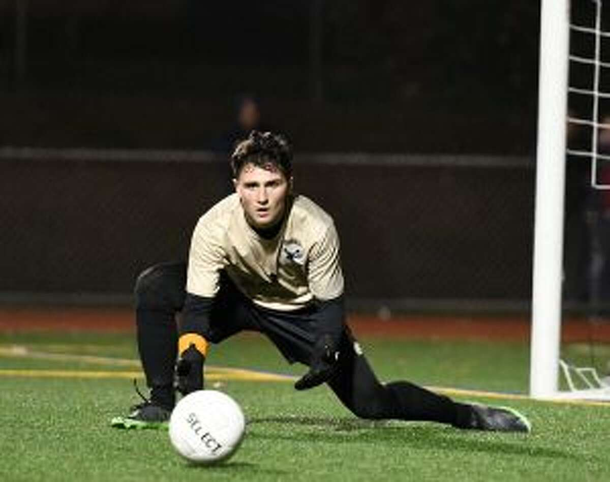 Chris Prizio makes one of his 12 saves that earned the Trumbull keeper game MVP honors.
