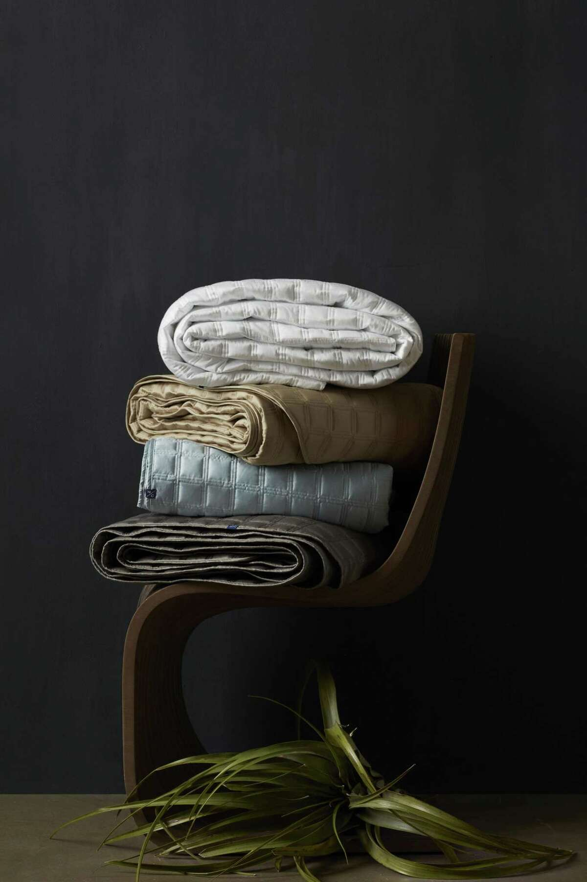 Coverlets are just one product made in 10 Grove's Houston workroom.