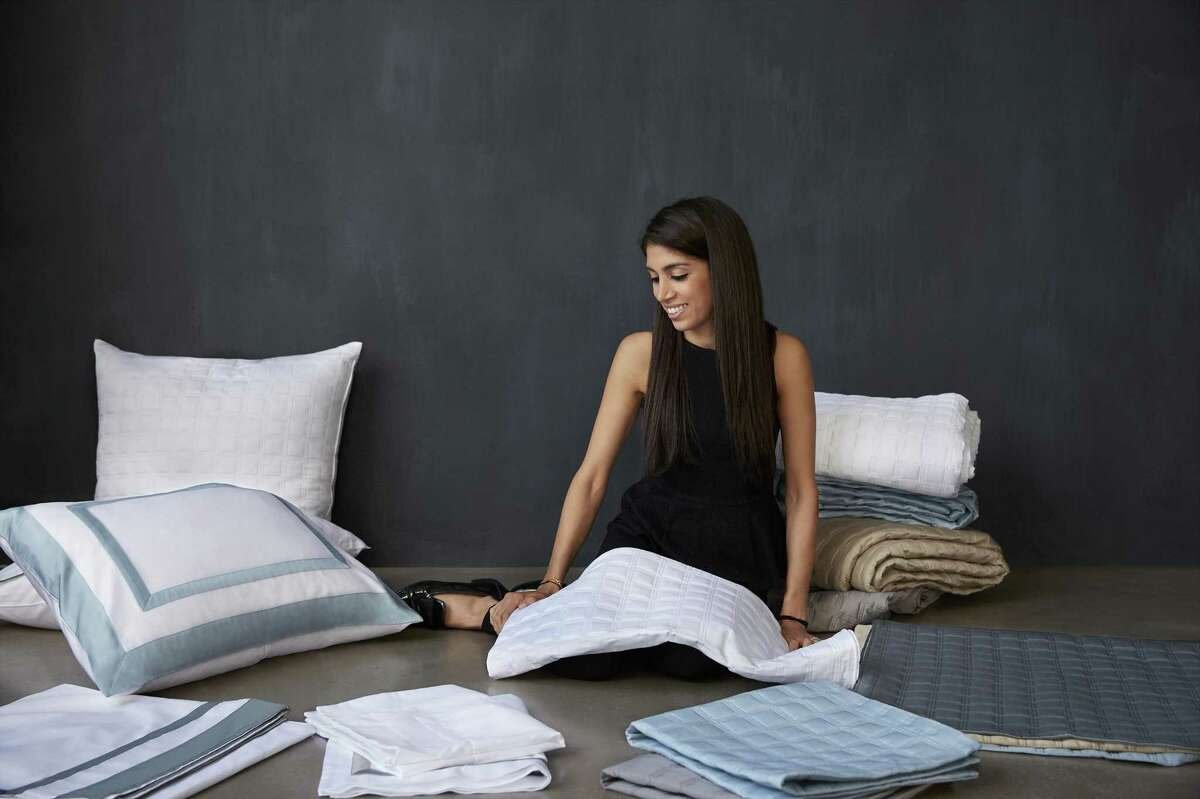 Rana Argenio, founder of 10 Grove luxury linens business, poses with samples of her products.