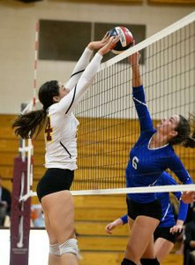 St. Joseph's Maddie Johnson and Ludlowe's Jackie Soderlund battle at the net. — David G. Whitham photo