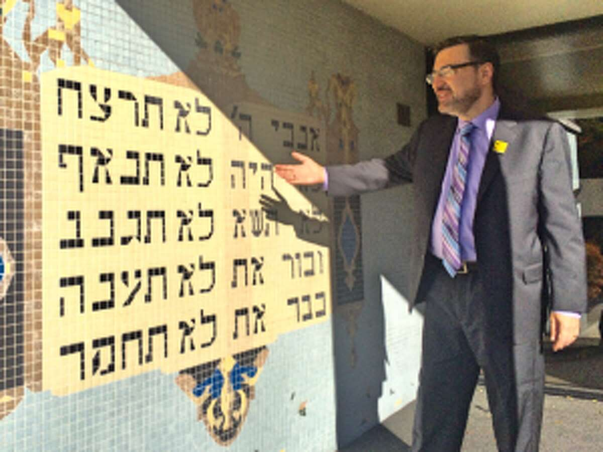 Brodie explains that the 10 Commandments, depicted in a mosaic at B'nai Torah's entrance, are universal to many of the world's religions.