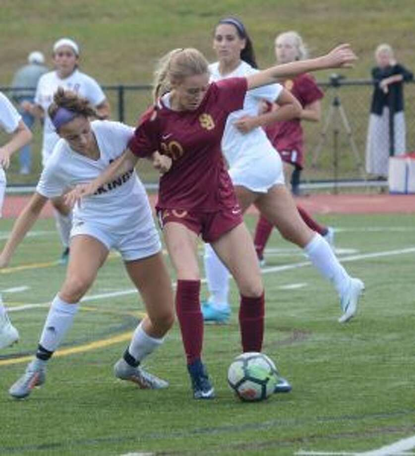 Maddie Fried (center) gave the Cadets the lead in their win over the Senators.
