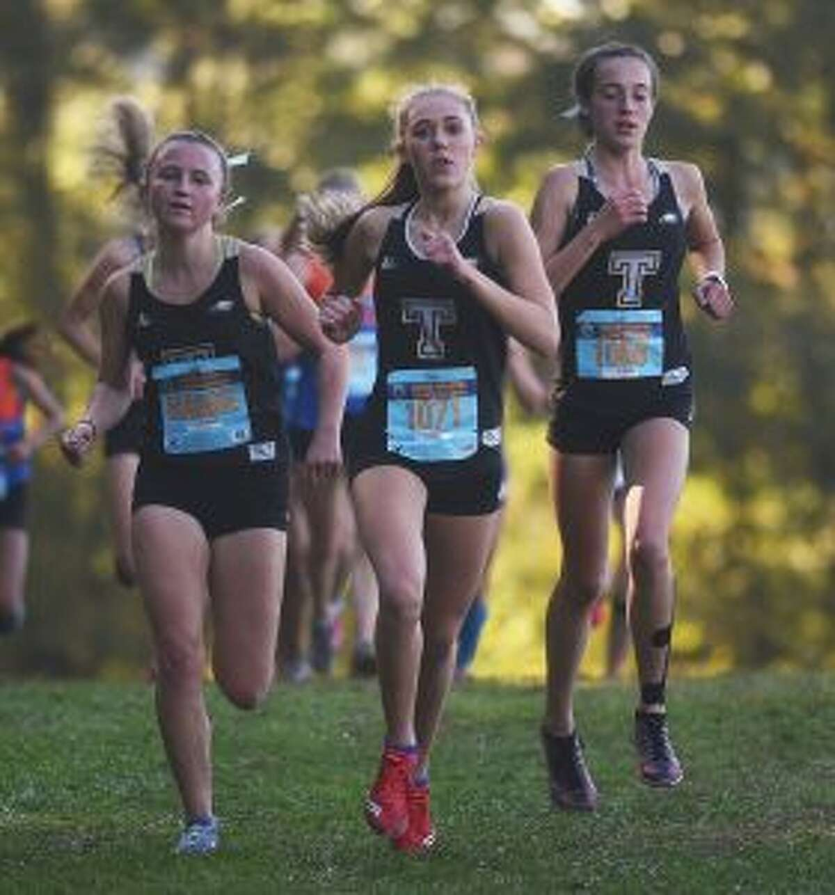 Maggie LoSchiavo, Kali Holden and Calyn Carbone show off All-FCIAC running form. - Dave Stewart photo