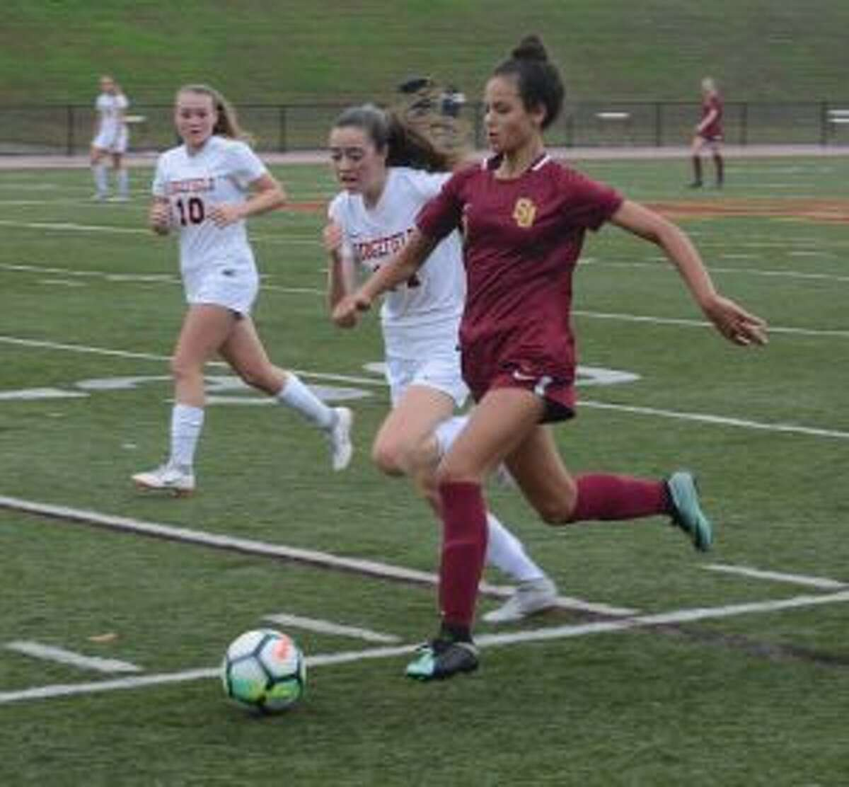 Sophia Lowenburg makes a run up the sideline. - Andy Hutchison photo