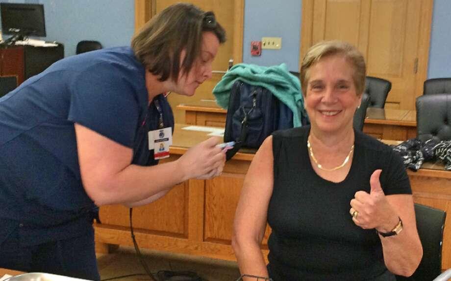 First Selectman Vicki Tesoro is all smiles after receiving her flu shot Tuesday. — Donald Eng photo