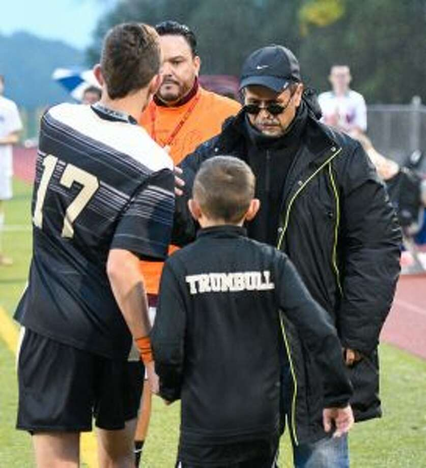 Trumbull coach Sebastian Gangemi shakes hands with the Eagles' Matthew Bagley on Sebe Night. — David G. Whitham photos
