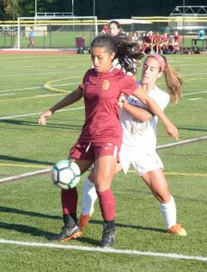 St. Joseph's Jessica Mazo deals with pressure applied by Jessica Esposito. — Andy Hutchison photos