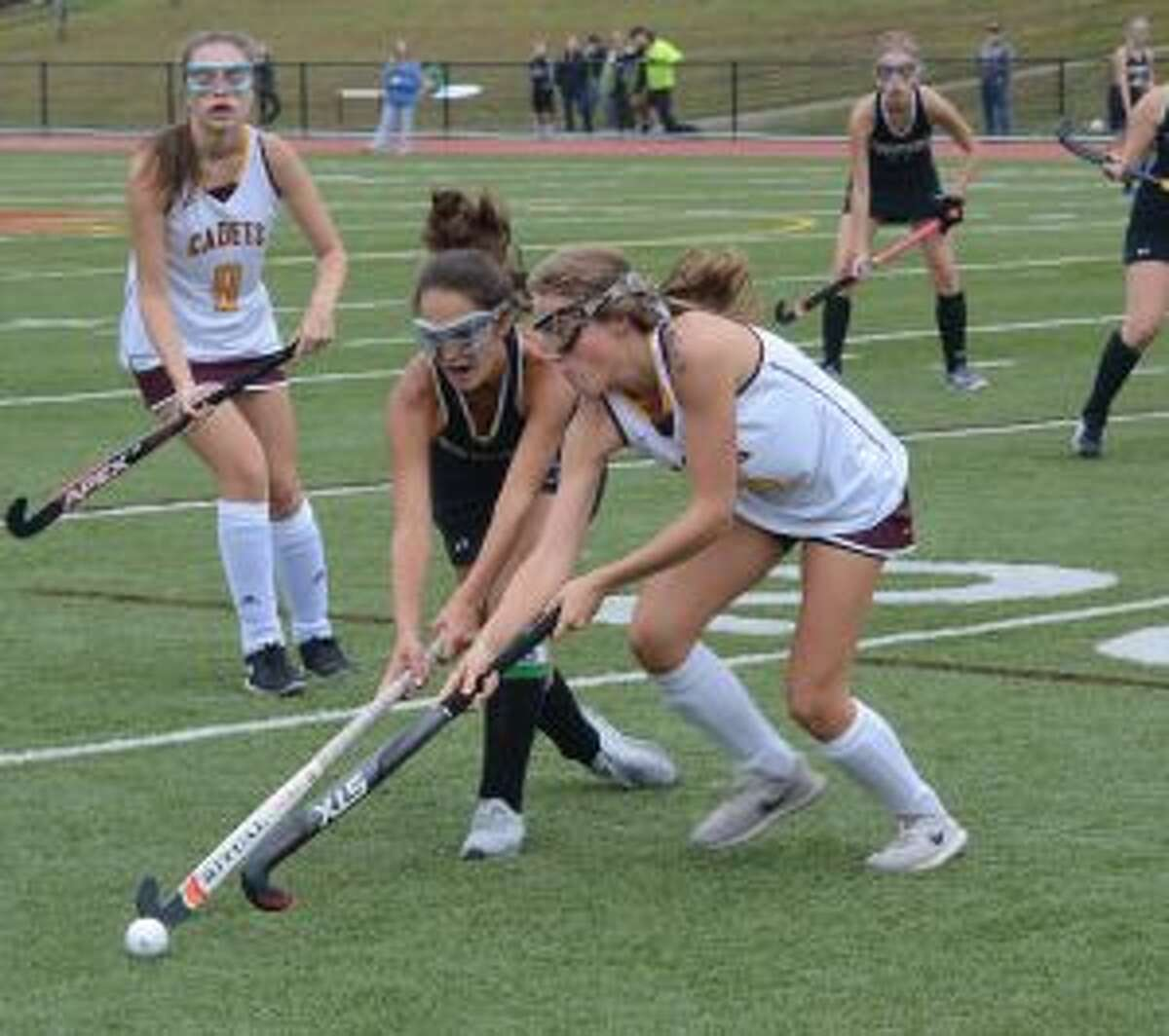 Trumbull's Olivia Giovannini and St. Joseph's Lily Norris compete for possession. - Andy Hutchison photos