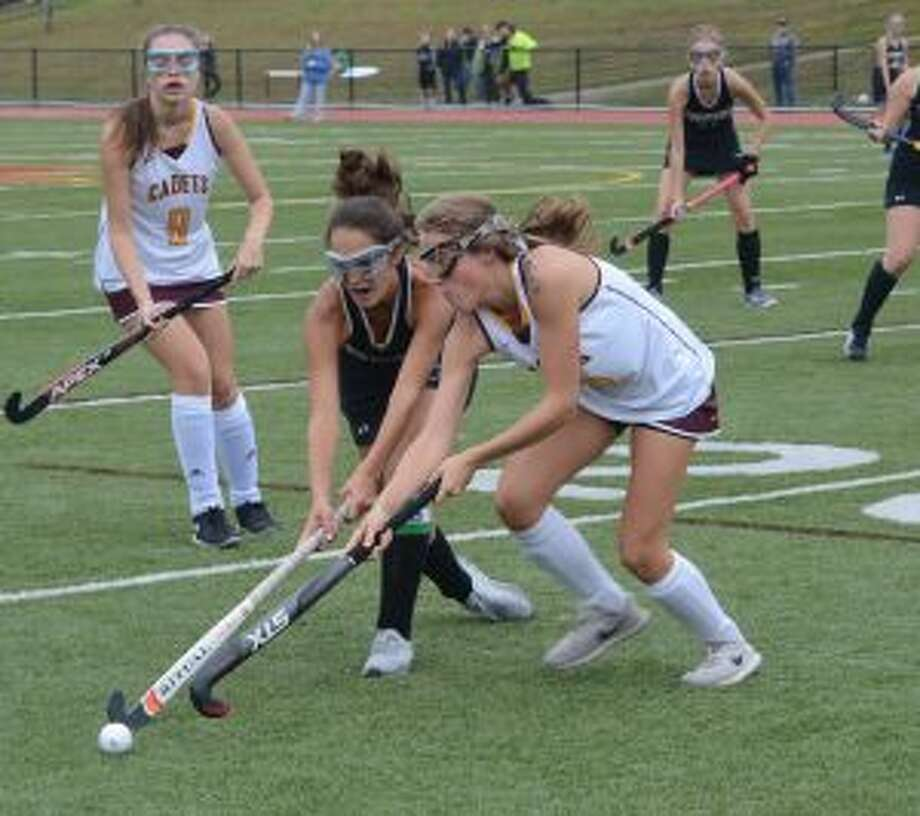Trumbull's Olivia Giovannini and St. Joseph's Lily Norris compete for possession. — Andy Hutchison photos