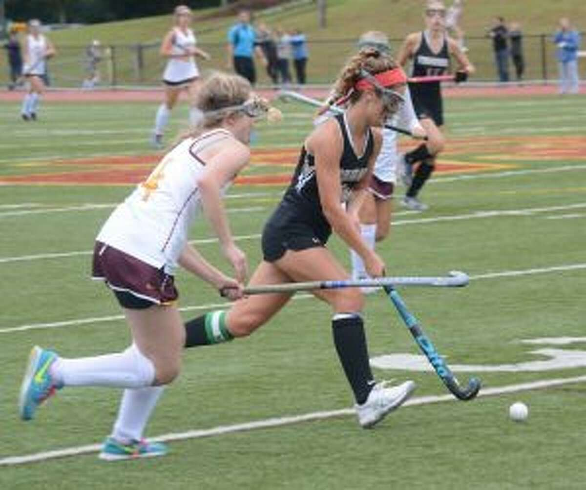 THS' Grace Shay looks to advance past the Cadets' Grace Seyfried.