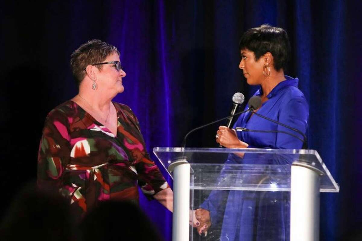 Tamron Hall (right) and Survivor Speaker Lori Bennett at Tuesday's Speaking of Women Luncheon. -Photo by Stan Godlewski.