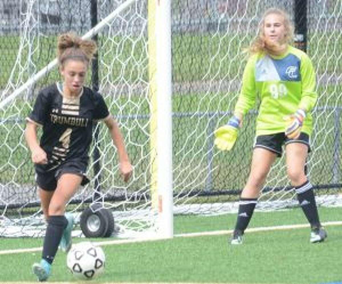 Mia DiBello looks to control the ball, as Ludlowe keeper Julia Pida waits. - Andy Hutchison photo