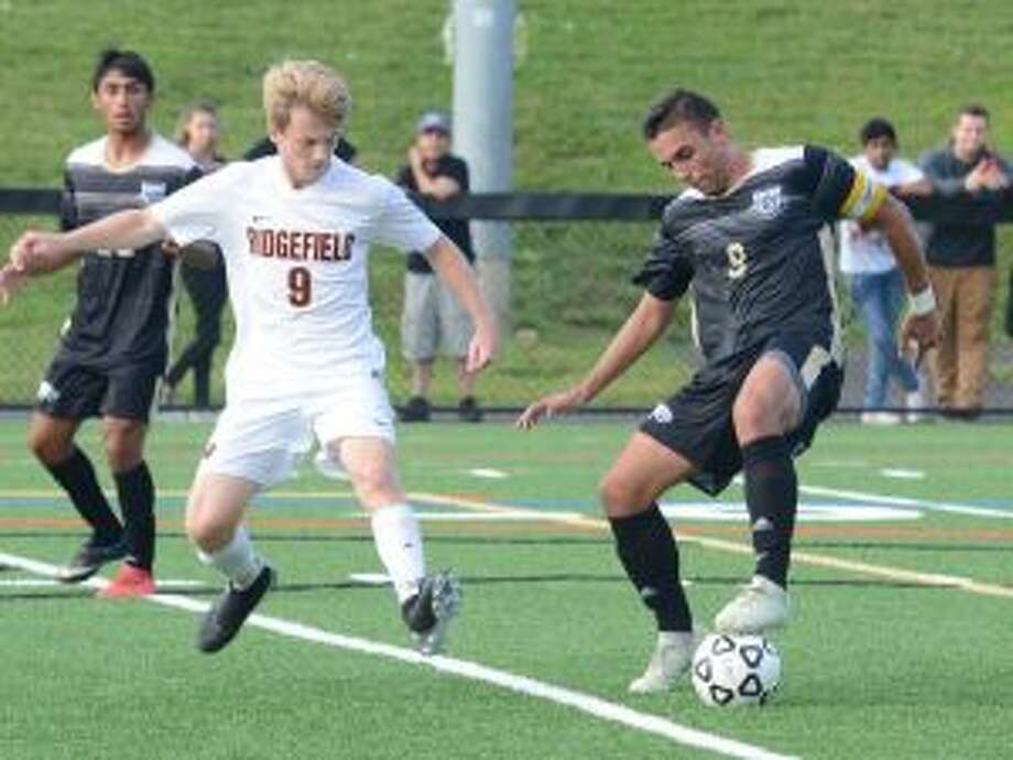 Jason Weinstein scored five goals and had an assist when Trumbull defeated Ridgefield, 6-2. — Andy Hutchison photo