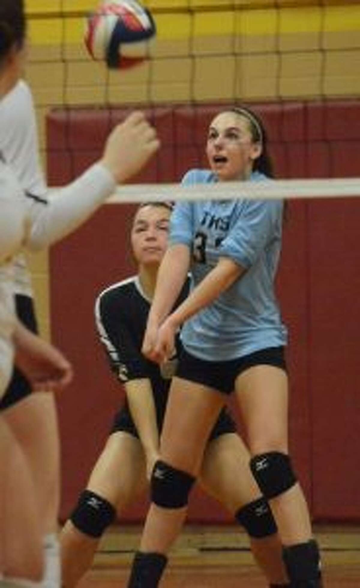 The Eagles' Rachel Hage makes a pass from her libero position.