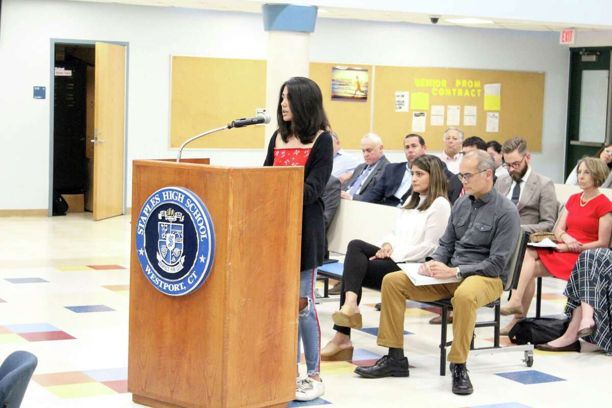 Staples High School senior Reva Kale addresses the Board of Education at their meeting Monday night. Her parents sit behind her. Taken June 3, 2019 in Westport.
