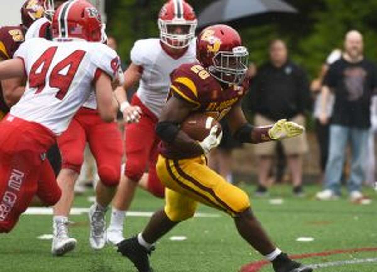 Jaden Shirden looks to cut back against New Canaan. The junior ran for 108 yards and two touchdowns. - Dave Stewart photos
