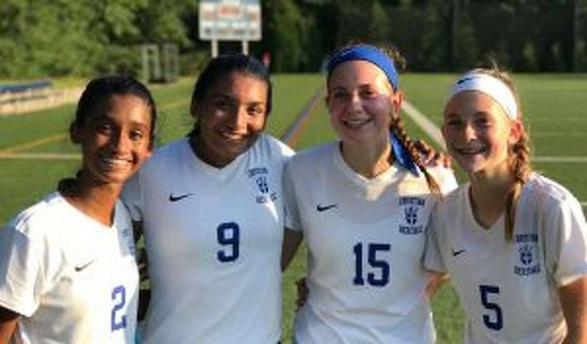 Natania Muriel, Ranita Muriel, Mia Angelini and Alex Angelini put up points in the win over King School.