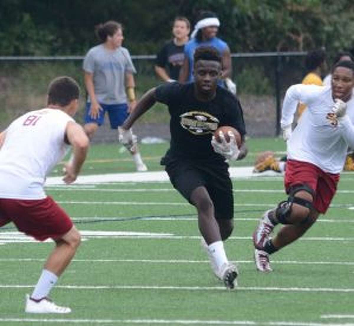 Trumbull High's Reggie Robinson looks for room to run in a 7-on-7 meeting with St. Joseph. - Andy Hutchison photo