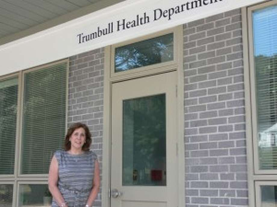 Rhonda Capuano, the director of the Trumbull Health Department, stands outside the town's new building on White Plains Road.