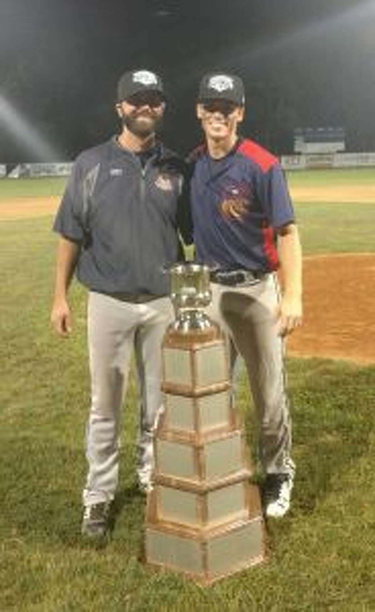 Simon Whiteman and John Raiola, Valley Blue Sox manager, stand with the Fay Vincent Sr. NECBL Championship Trophy.