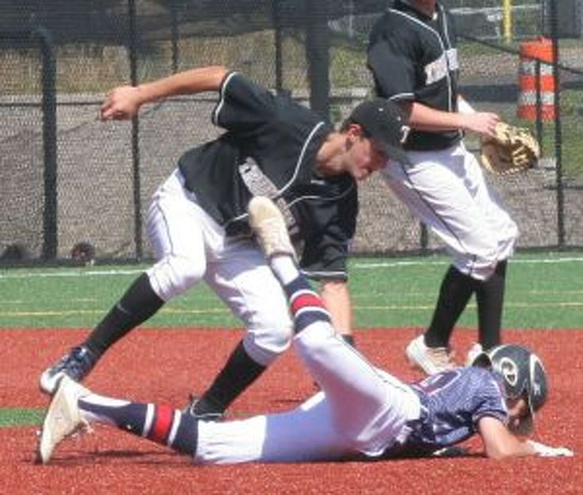 Trumbull's Jack Wallace tags out Pittsfield's Michael Britten in a second-inning rundown. - Bill Bloxsom photos