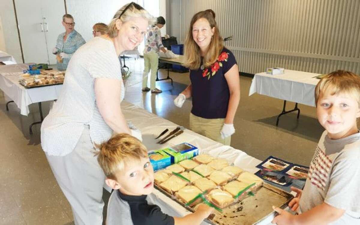 Volunteers from St. Matthew's Episcopal of Wilton help prepare meals.