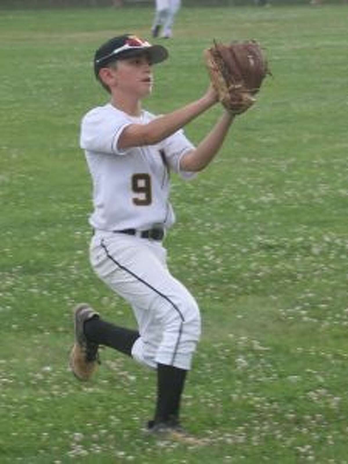Trumbull's Jackson DePino makes this over the shoulder catch in the in the third inning.