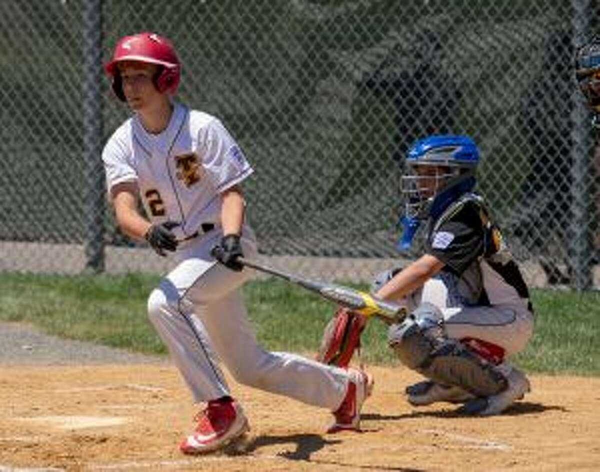 Trumbull National's Matthew Wood puts the ball in play in the bottom of the first inning. - David G. Whitham photos