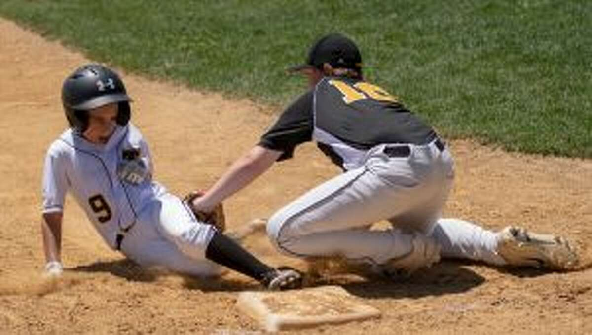 Trumbull American's Dylan Lamy gets the tag down on Trumbull National's Jackson DePino.