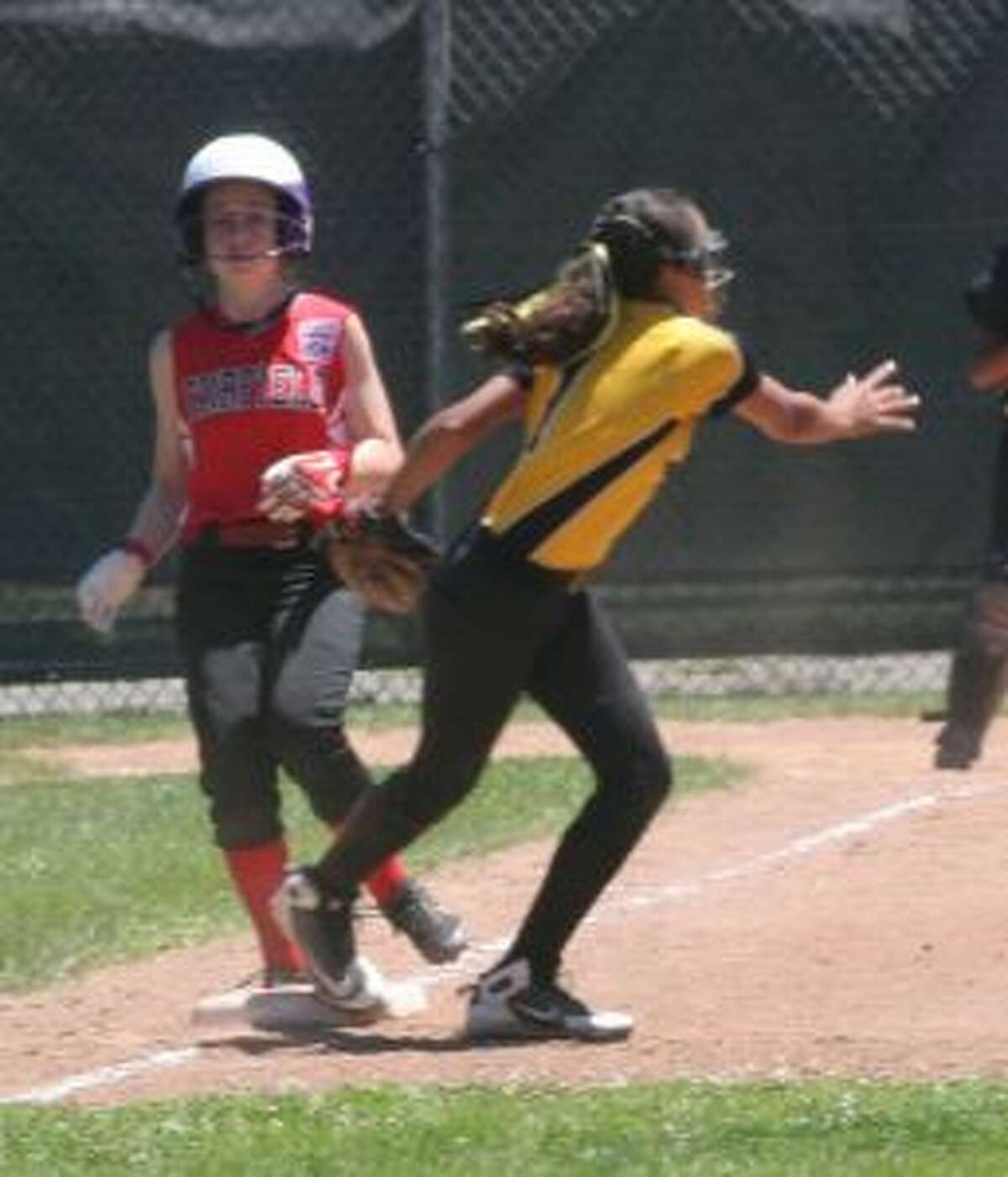 Trumbull's Raylen Massey comes off the bag after getting the put out at first base on Fairfield's Paige O'Neill. - Bill Bloxsom photo
