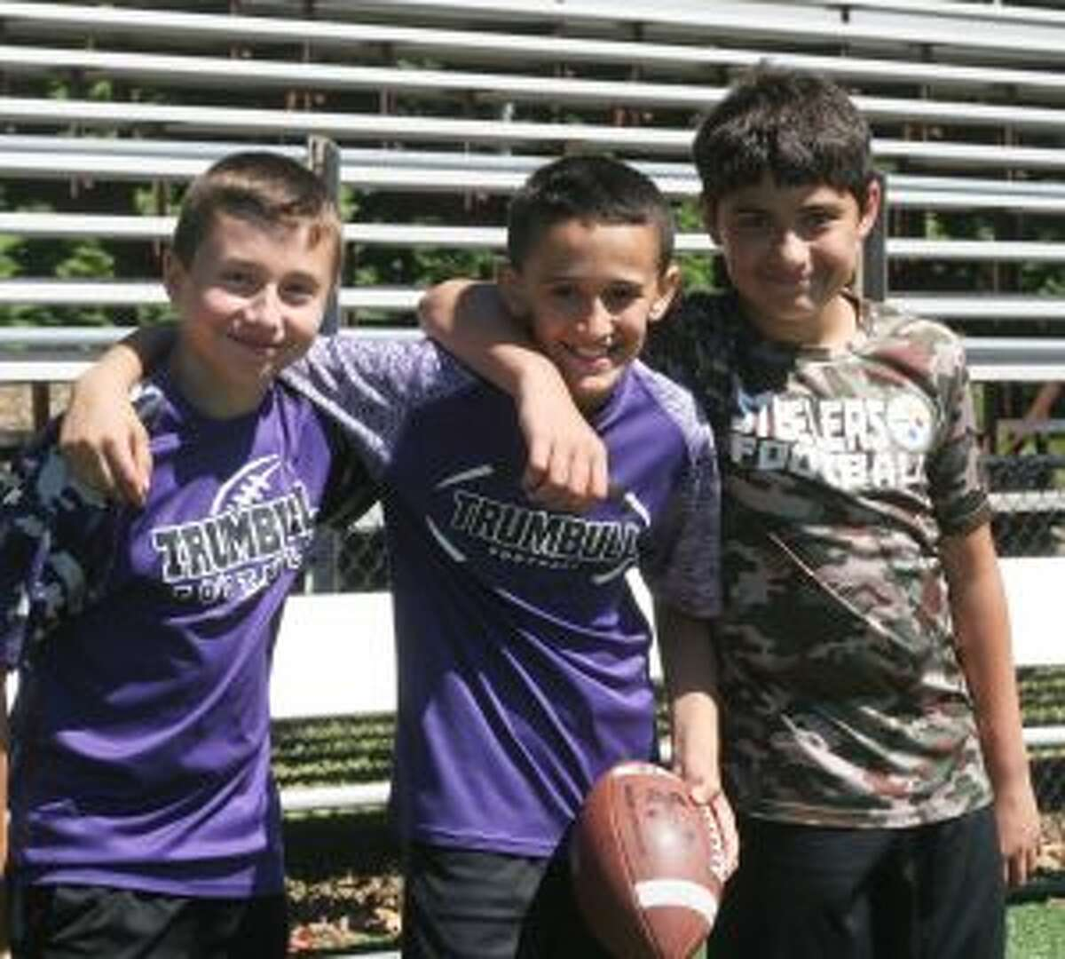 Trumbull Rangers players Wesley Dayton, Joey DiMarco and Vincent Desautels take a break near a water station. - Bill Bloxsom photo