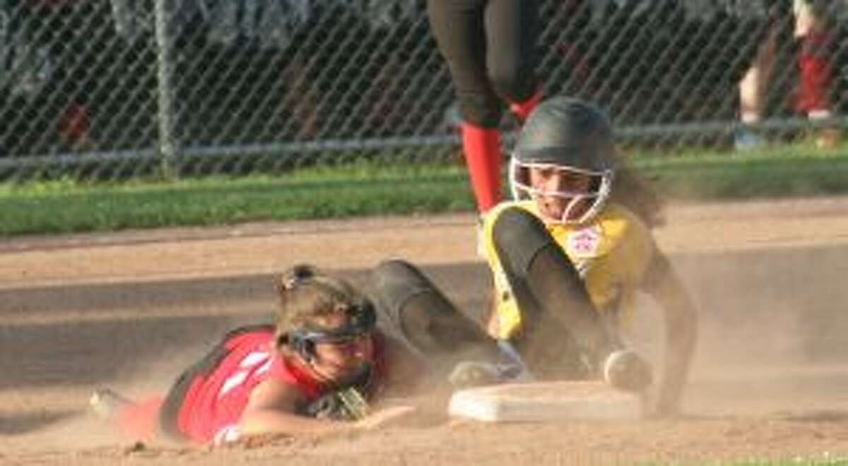 Trumbull's Raylen Massey slides in safely at second base, as Fairfield's Griffin Paladino looks to make a play. - Bill Bloxsom photos