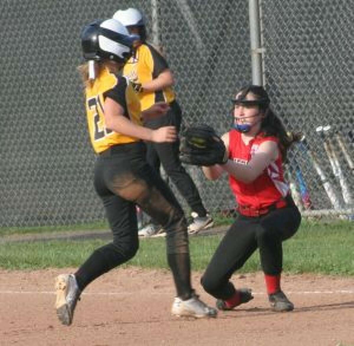 Fairfield's Paige O'Neill tags out Trumbull's Brianna Buda.