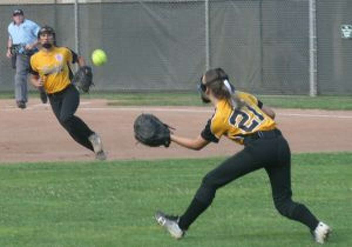 Trumbull's Brianna Buda makes the catch in left field on Alyssa Russo's bid for a base hit.