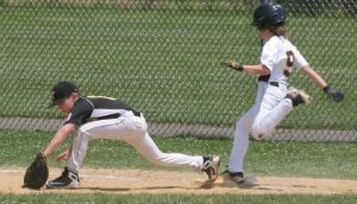 Trumbull American's Sam Kubie makes the stretch to nip Trumbull National's Ben Parente. - Bill Bloxsom photos